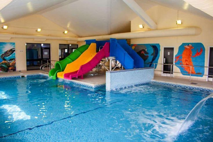 Indoor Swimming Pool With Slides Bathroomtropicallighting Indoor Swimming Pools Swimming Pools Indoor Swimming