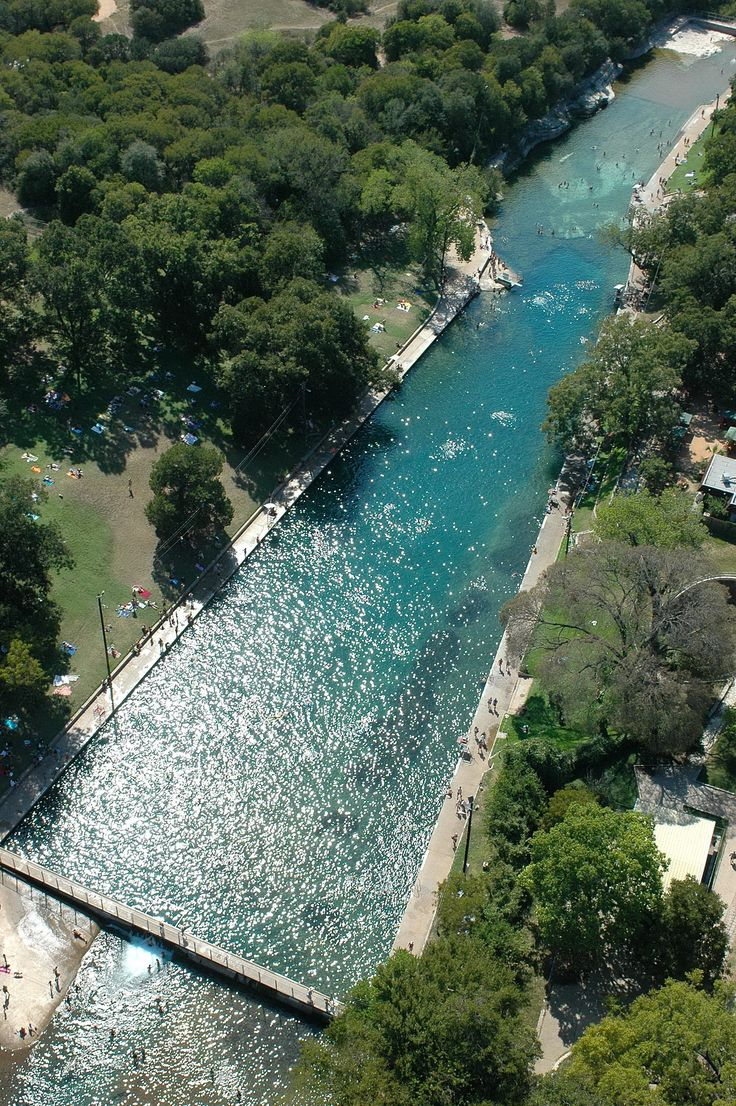Barton Springs at Zilker Park in Austin, Texas. See the dam at the bottom left corner? My dad walked us over it one year when the creek was flooding. Dad...ever one for adventure.