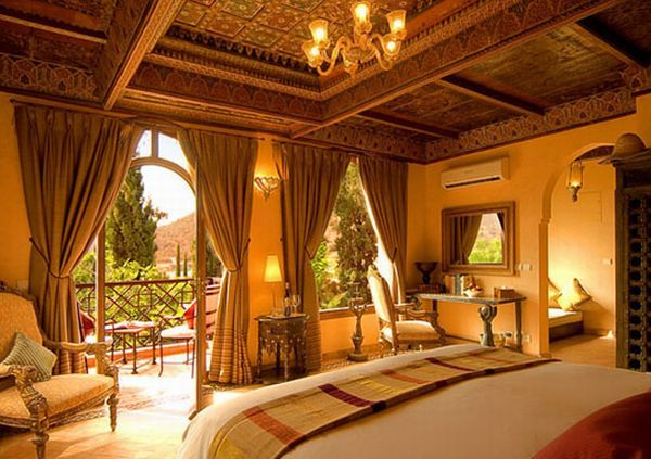 Exotic bedroom with Moroccan style mango color scheme