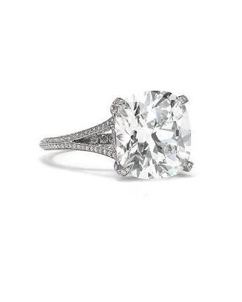 Cushion-cut diamond split-shank ring set in platinum, Tiffany & Co., tiffanyandco.com, 800-526-0649.