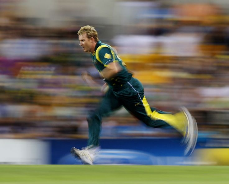 Brett Lee, one of the fastest bowlers in the world, in full flow. The blur says it all, ball gonna come in at 150k!