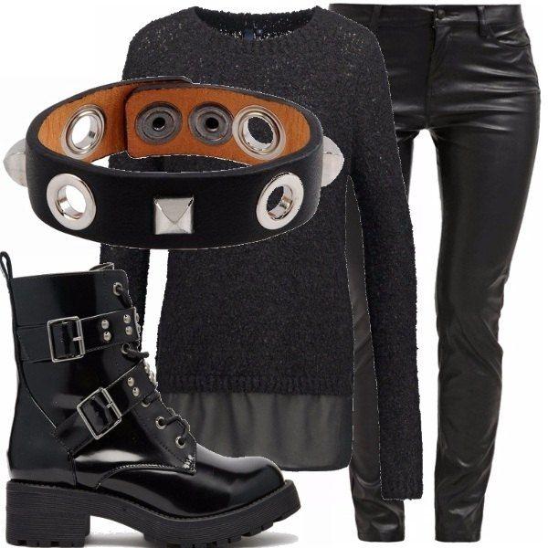 Look perfetto per chi ama lo stile dark: pantaloni di pelle nera, maglioncino di lana con inseto in velo, anfibi con le borchie e immancabile il braccialetto di pelle nera!