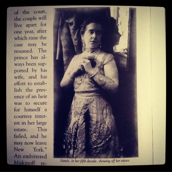 """The lovely & wild Aimée Crocker. Born in 1864, pictured here in her 5th decade. She traveled the world (before jets!), had tattoos, purple hair, did yoga, became a Buddhist, divorced 4 times, and wrote a memoir called """"And I'd Do It Again"""". Check out the snake tattoos on her left arm. Gorgeous! (This pic is from """"Aimee Crocker's Refined Vaudeville"""" by K.M. Taylor, 2009)"""