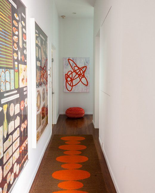 Not just another neglected hallway, artist Jen Wink's features a Jonathan Adler runner, vintage biology posters, and one of her own paintings.