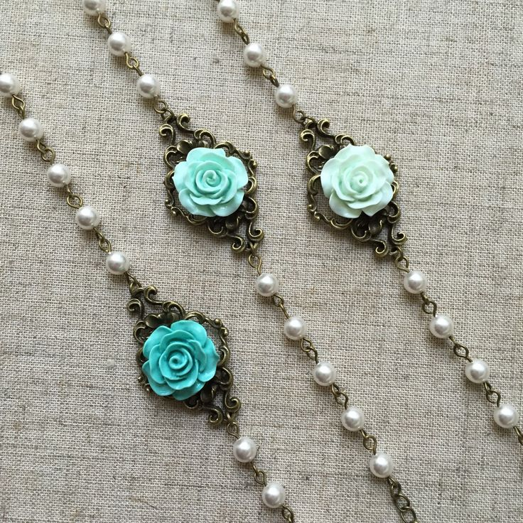 A personal favorite from my Etsy shop https://www.etsy.com/listing/230816466/set-of-3-pearl-bracelets-with-flowers-in