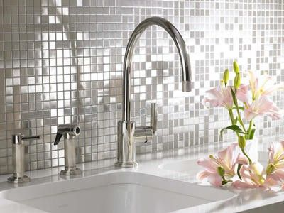 Silver mirror mosaic tiles, enhanced by closely matching grout.