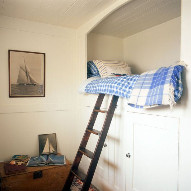 bed nook with ladder and storage below