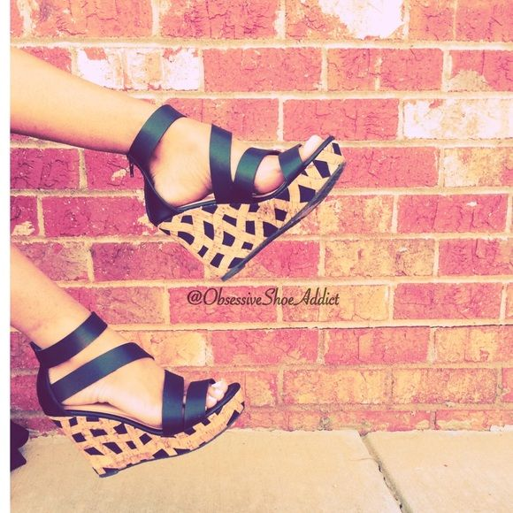 Susy Black Wedge Sandal Prices are marked at the lowest, so prices are firm. Only Bundles receive discounts. For sales, subscribe to newsletter through Obsessive Shoe Addict Website and follow on Instagram.  Black upper PU leather Back zipper Cork wedge Brand: Maker's 4 inch heel makers Shoes Wedges