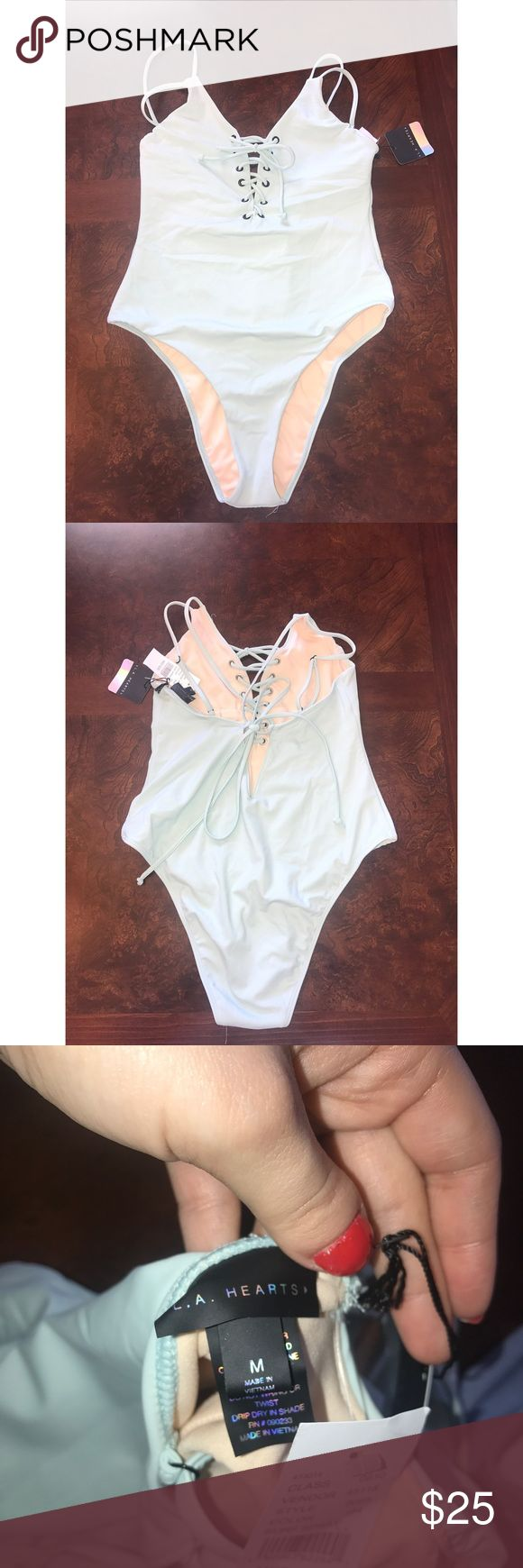 Pacsun bathing suit! -ties in the front and back PacSun Swim One Pieces