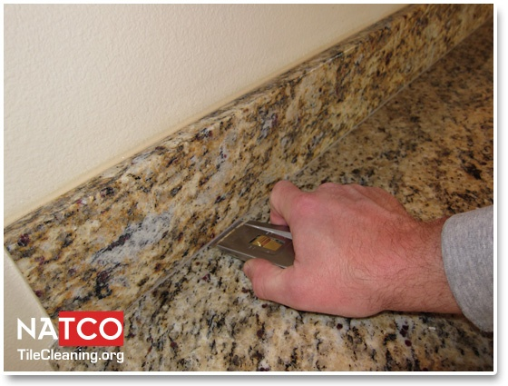 removing caulk with razor blade tool re caulking granite