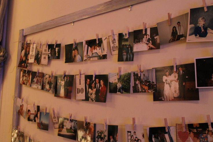 Photos on a line attached by clothespins. Shabby chic surprise party.