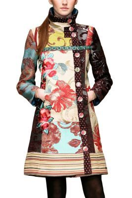 Desigual women's Luciole coat. The different scraps of fabric give the garment its unique texture. The off-centre row of buttons breaks up the symmetry in this garment.