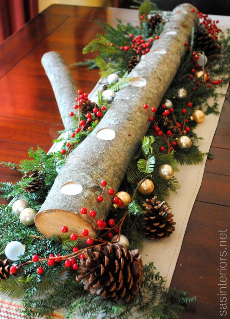 Bring nature indoors with this up-cycled center piece: Log Centerpiece using natural greenery, berries, pinecones, and a few small ornaments #upcycling #nature
