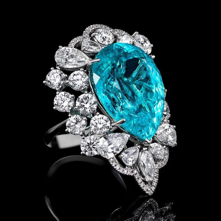 28cts Paraiba tourmaline ring surrounded by flawless white diamonds by ORLOV (@orlovjewelry)