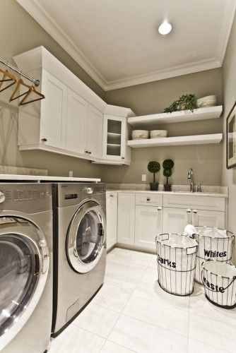This is a good layout for an organized laundry room, especially since I'll be getting stainless steel front loaders and the laundry/utility room in my new townhouse looks similar to this.