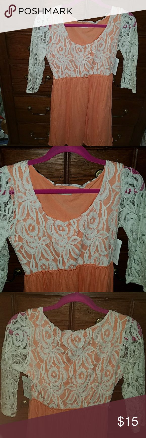 Lace dress from the mint julep boutique! NWT LG Perfect spring dress! Lace and apricot. Above the knee. Never Worn! Size large Dresses Midi