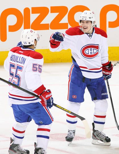 April 25 - Francis Bouillon gives Brendan Gallagher a pound for his goal.