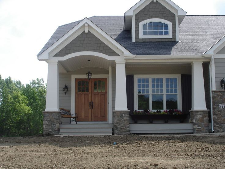 Exterior Columns | craftsman style home with front porch and crisp white columns | Bayer Built Woodworks