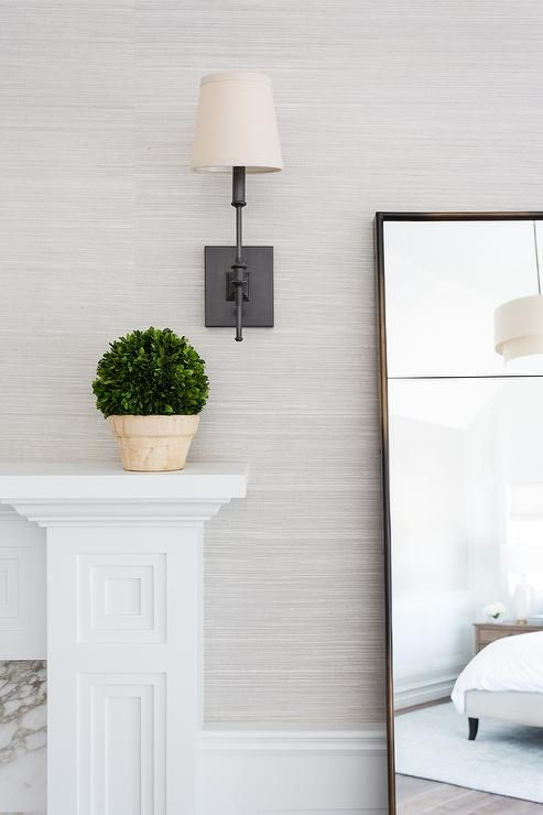 White Wooden Fireplace Mantel Features Light Gray Grasscloth Wallpaper Finished With A Cre In 2020 Feature Wall Living Room Feature Wall Bedroom Grey Wallpaper Bedroom
