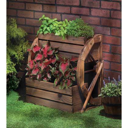 13842+Wagon+Wheel+Double-tier+Planter. Enjoy your garden in a whole new way.