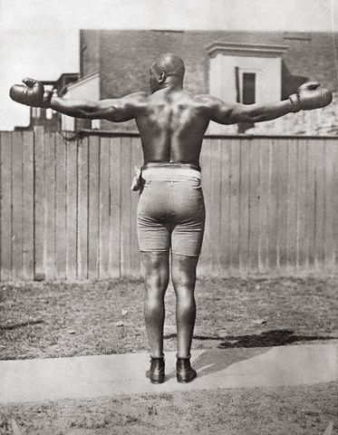 "BOXING: Heavyweight Boxing Champion Jack Johnson Posing Outdoors Date Photographed: ca. 1915 | Total fights 104, Wins 73, Wins by KO 40, Losses 13, Draws 10. Johnson had a huge reach and always looked taller than his actually 6' 1/2"" Still a big man for the times. at the height of the Jim Crow era—became the first African American world heavyweight boxing champion (1908–1915)."