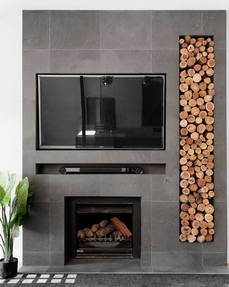 We designed and installed this Bluestone fireplace with firewood storage in our #BrightonProject. Along with looking super chic, it provides a comforting feature and sets the tone for the entire lounge area. For more inspiration and information visit the link in our bio