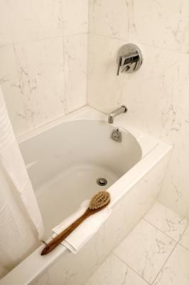 How to Unclog a Bathtub Drain With Baking Soda  ALSO, to unclog sink drains use 1/2 cup of baking soda, 1/2 white vinegar, and boiling water.  Put baking soda down drain; then pour vinegar down drain; then follow it with boiling water (at least 2 cups).