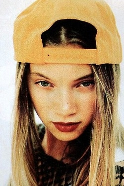 Amy Smart in an Axl Rose-themed photo spread in Sassy, 1992.