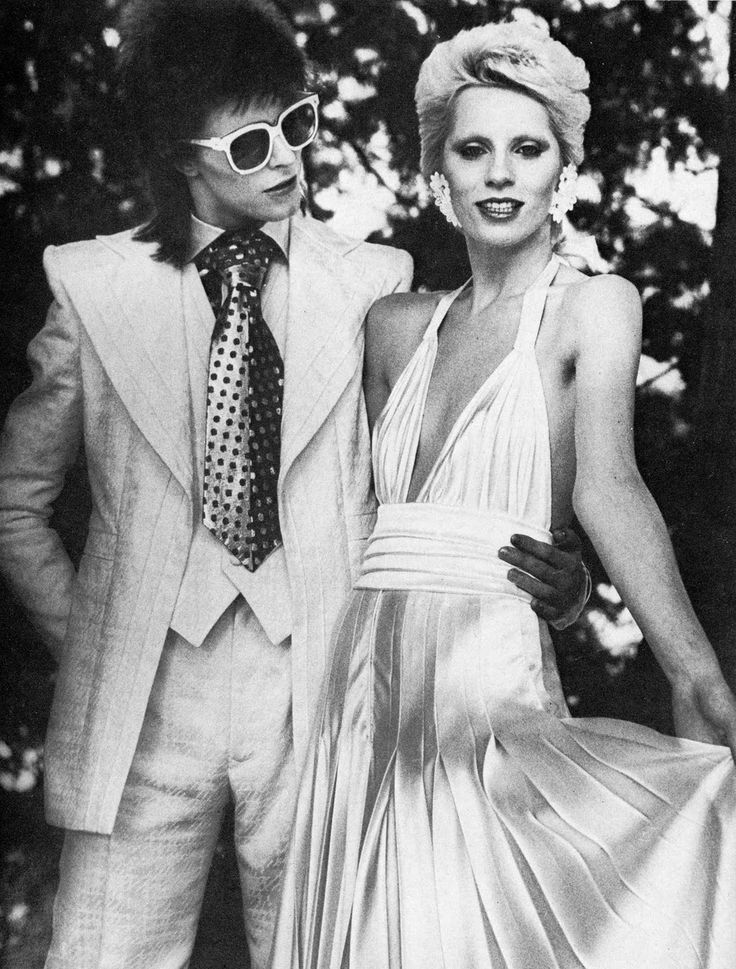 Angie and David Bowie. This chick inspired Mick Jagger to write the popular Stones song named for her. As well as Eric Clapton's 'Bell Bottom Blues' She also married David Bowie. The envy of every rock groupie in the 70's.