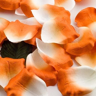 Tangerine faux rose petals.  Great for scattering over tables for colour and decor.  Available in many colours.  £4.99, order online at the Fuschia Boutique at www.fuschiadesigns.co.uk.