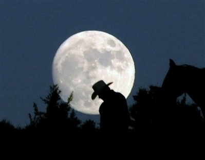 Add  .      The moon light reflects the cow boy.                      The moon light caw boy