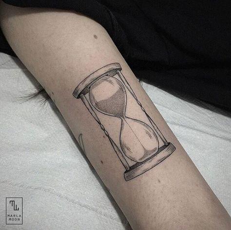 Elegant dotwork hourglass tattoo by Marla Moon