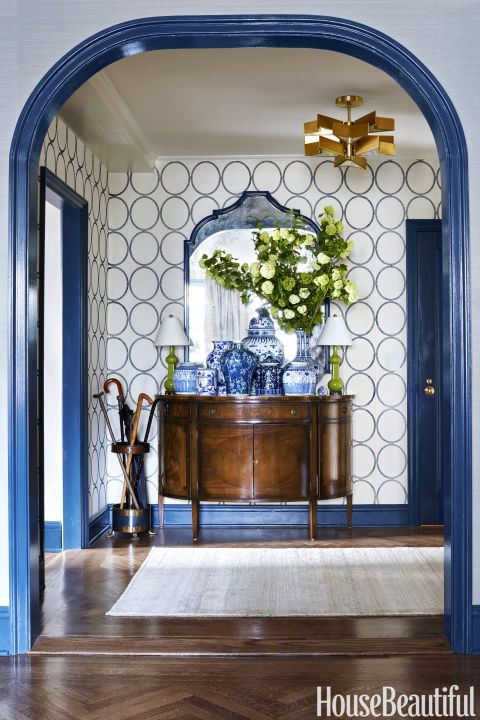 Bachman Brown Clem - House Beautiful High gloss trim in Benjamin Moore Twilight is an unexpected choice that works beautifully with the Phillip Jeffries wallpaper and collection of blue and white Chin