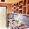 "The rooftop kitchen is decorated with antique #Moroccan tiles. From ""A Stellar Renovation in Morocco."""