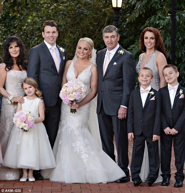 Happy family: Jamie Lynn Spears posed with (L-R) mother Lynne, daughter Maddie, husband James Watson, father James, sister Britney and nephews Jayden James and Sean Preston on her wedding day on Friday
