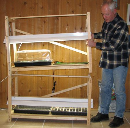 Here's a stand made out of wood. If you can measure. and cut, and use a drill, I can't see how this would be hard.
