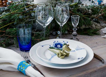 Traditional Royal Copenhagen Christmas table with marizpan animal.