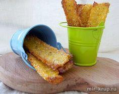 Чипсы из кукурузной крупы.Вода – 1,5 чашки Кукурузная крупа – 0,5 чашки Растительное масло - для смазывания Соль, сахар, специи – по вкусу