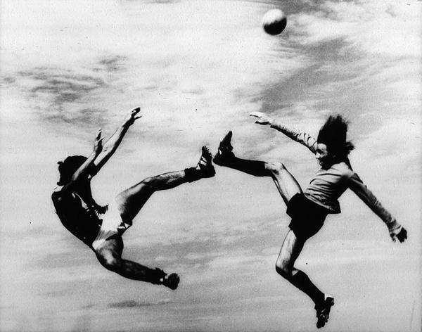 Photographer/Creator  Pedro Luis Raota  Collection  1973  Publisher  El Heraldo  Caption/Description  Two soccer players fight for the ball.