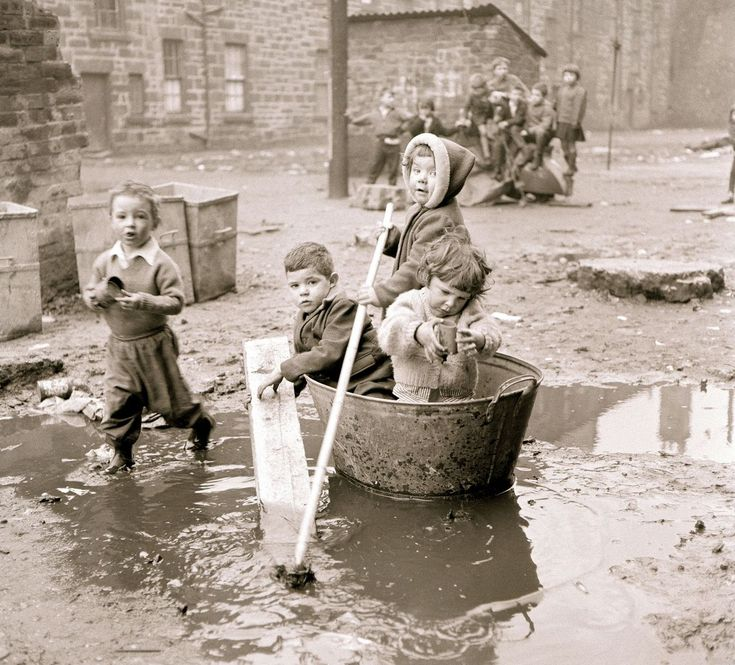 Children play in the housing slums in the Gorbals district of Glasgow. 1966