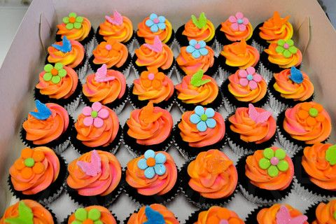 Bright flower cupcakes from the Cupcake Shop