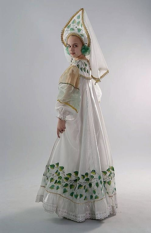 A pretty girl dressed in a stylized Russian costume.