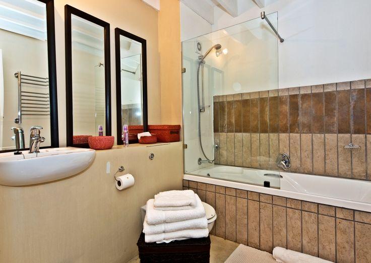 Unit 3A:  Bottom floor bathroom with bath/shower, toilet and basin.