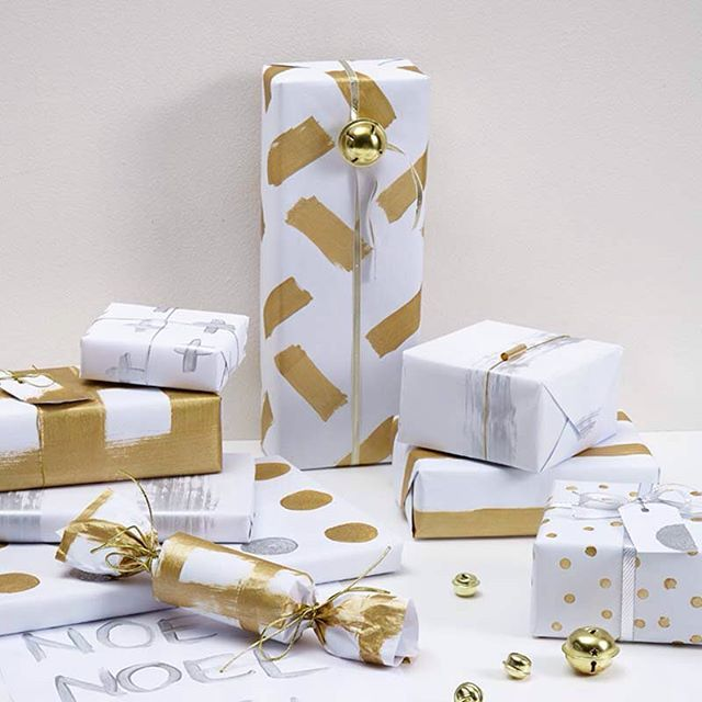 Xmas bright idea: Resene testpots and white A3 paper equal stylish wrapping paper. Use round dab brushes to create the spots.  Paint: Resene Solid Gold and Resene Silver Aluminium, styled by #VanessaNouwens  #Resene #habitatbyresene #DIYmerrychristmas #merrychristmas #merrychristmasDIY #gold #goforgold