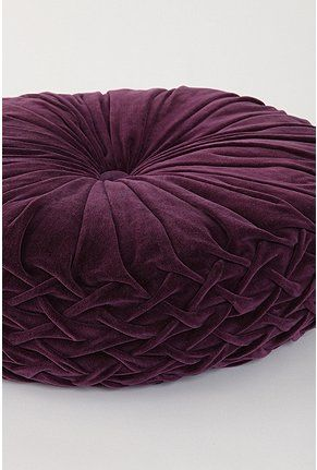 purple smocked pillow~ I wonder.... could I find a tutorial to make a large floor cushion like this?