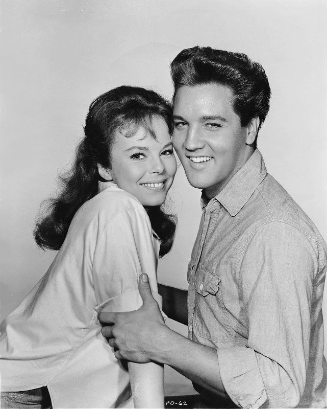 """Holly Jones (Anne Helm) and Toby Kwimper (Elvis Presley) - Photo shoot for Elvis's ninth movie, """"Follow That Dream"""" (United Artists) in August (September) 1961   The movie was filmed from July 6 to August 28, 1961 in Florida and Hollywood and opened nationwide on May 23, 1962. See more photos from the photo shoot: https://elvicities.com/~epss/gallery/follow-that-dream-1961/"""