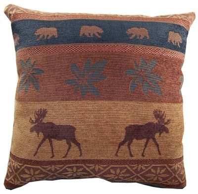 The Auburn Moose pillow features earth tone colors and images of moose, maple leaves, and bears ...