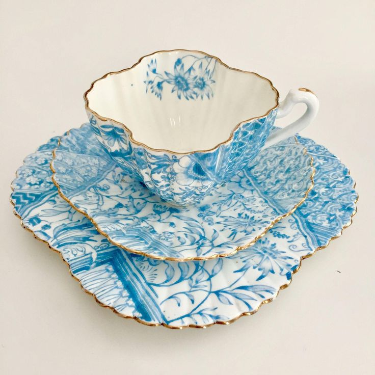"Antique Charles Wileman teacup trio, turquoise ""Dolly Varden"" patt 3740 on Alexandra shape, 1887"