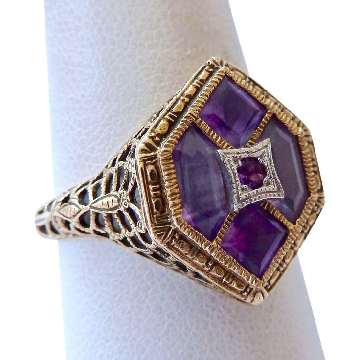 Exceptional, art deco, hexagonal, 14K gold amethyst ring. featuring 2 elongated hexagonal amethyst gemstones, two square amethyst gemstones, and one round amethyst gem stone in the center, set in a