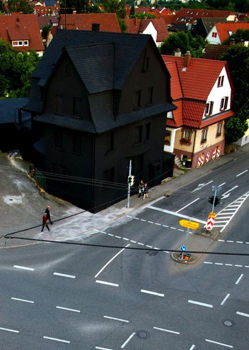 Haus in Schwarz (House in Black) 2008 by Simon Jung and Erik Sturm, Klasse Gregor Schneider. The house had been marked for demolition, and before being painted black, had long been used as a canvas by street artists.